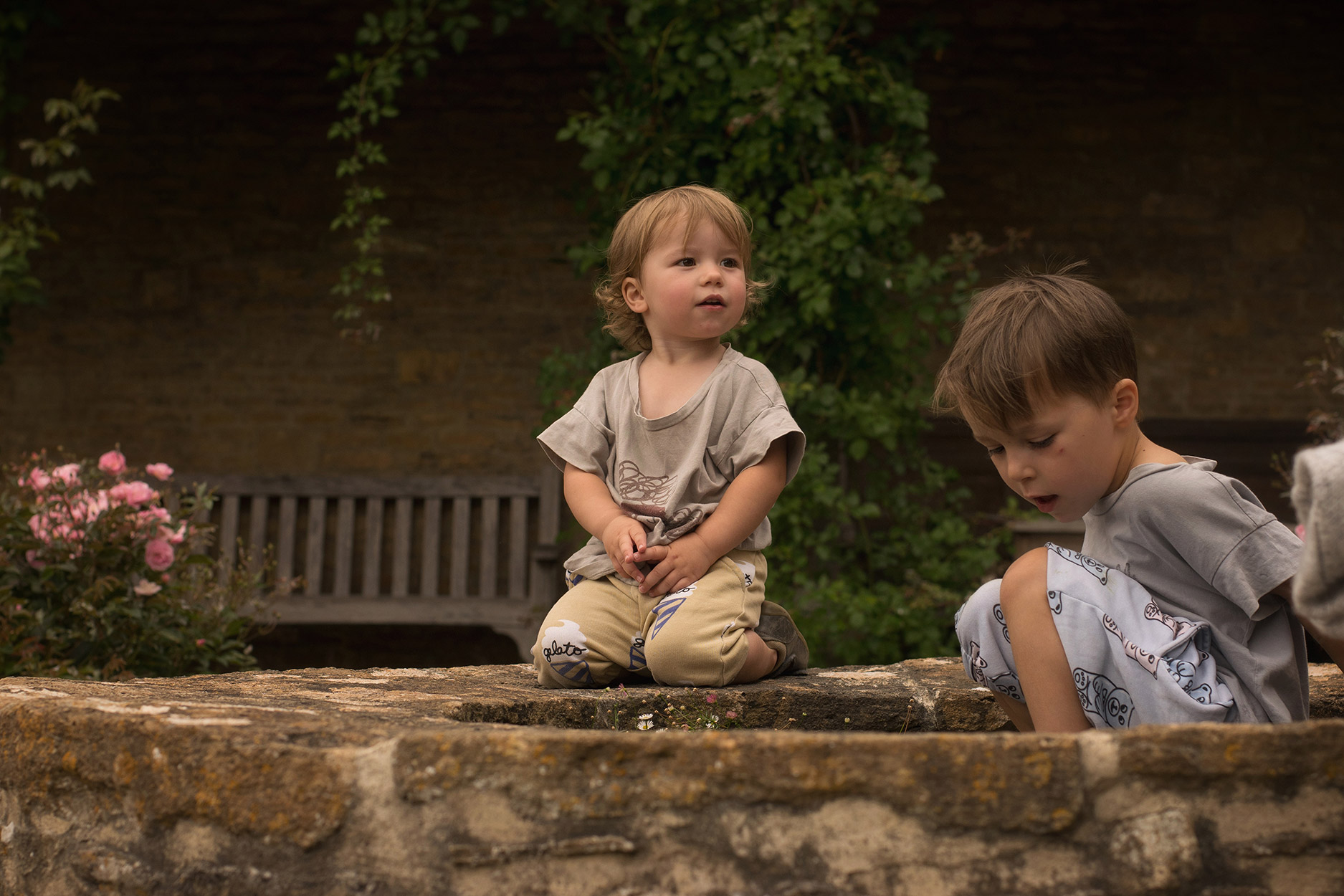 Family of two young boys wearing Hugo Loves Tiki, Bobo Choses and Bobux and Nanny visiting Great Chalfield Manor House and Gardens, National Trust, Melksham
