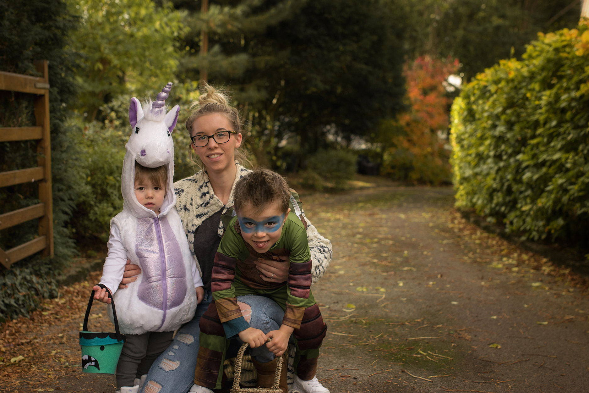 Trick or treating at Nanny's cottage wearing unicorn costume and Ninja Turtle outfit, two brothers with Mummy and Nanny