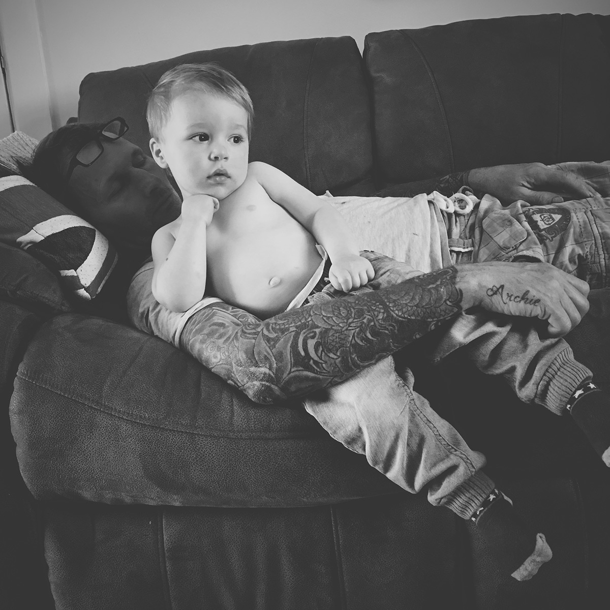 Our month in insta-snaps; April 2016 - Toddler watching TV whilst cuddling with Grandad who has name tattoo on his hand