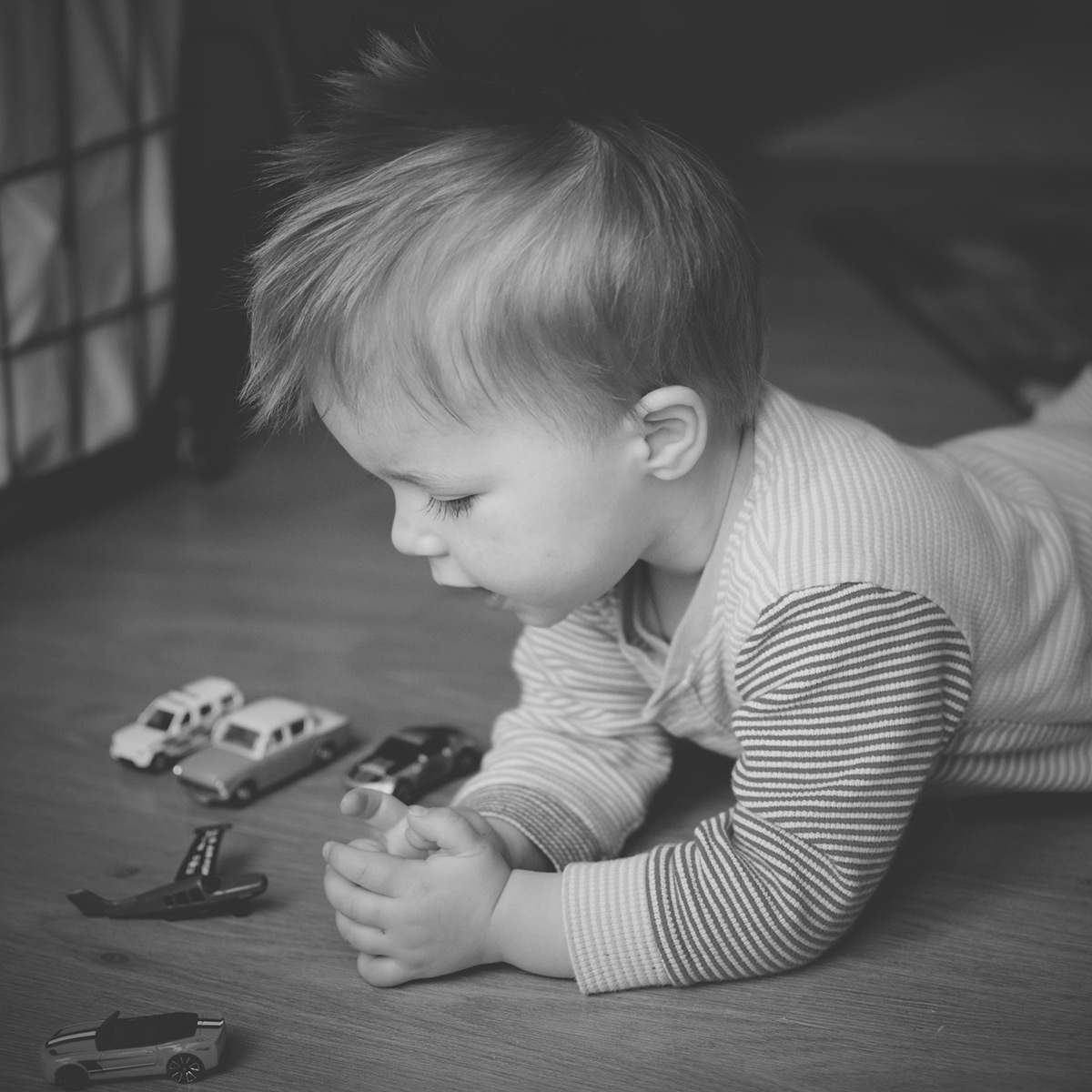 Our month in insta-snaps; April 2016 - Toddler wearing Little Bird by Jools Oliver onesie playing with toy cars with bed hair