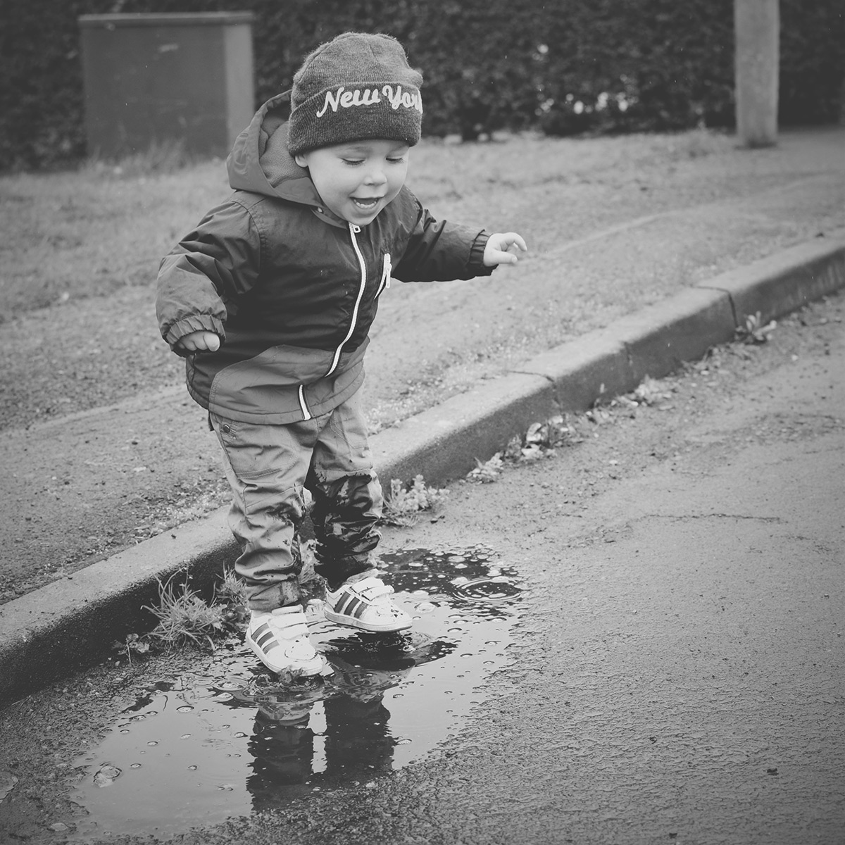 Our month in insta-snaps; April 2016 - Toddler action shot jumping into a muddy puddle splashing