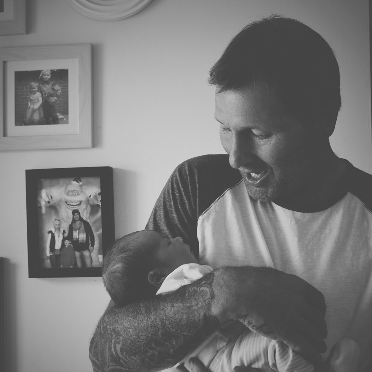Our month in insta-snaps; August 2016 - Grandad holding new baby boy grandson for the first time