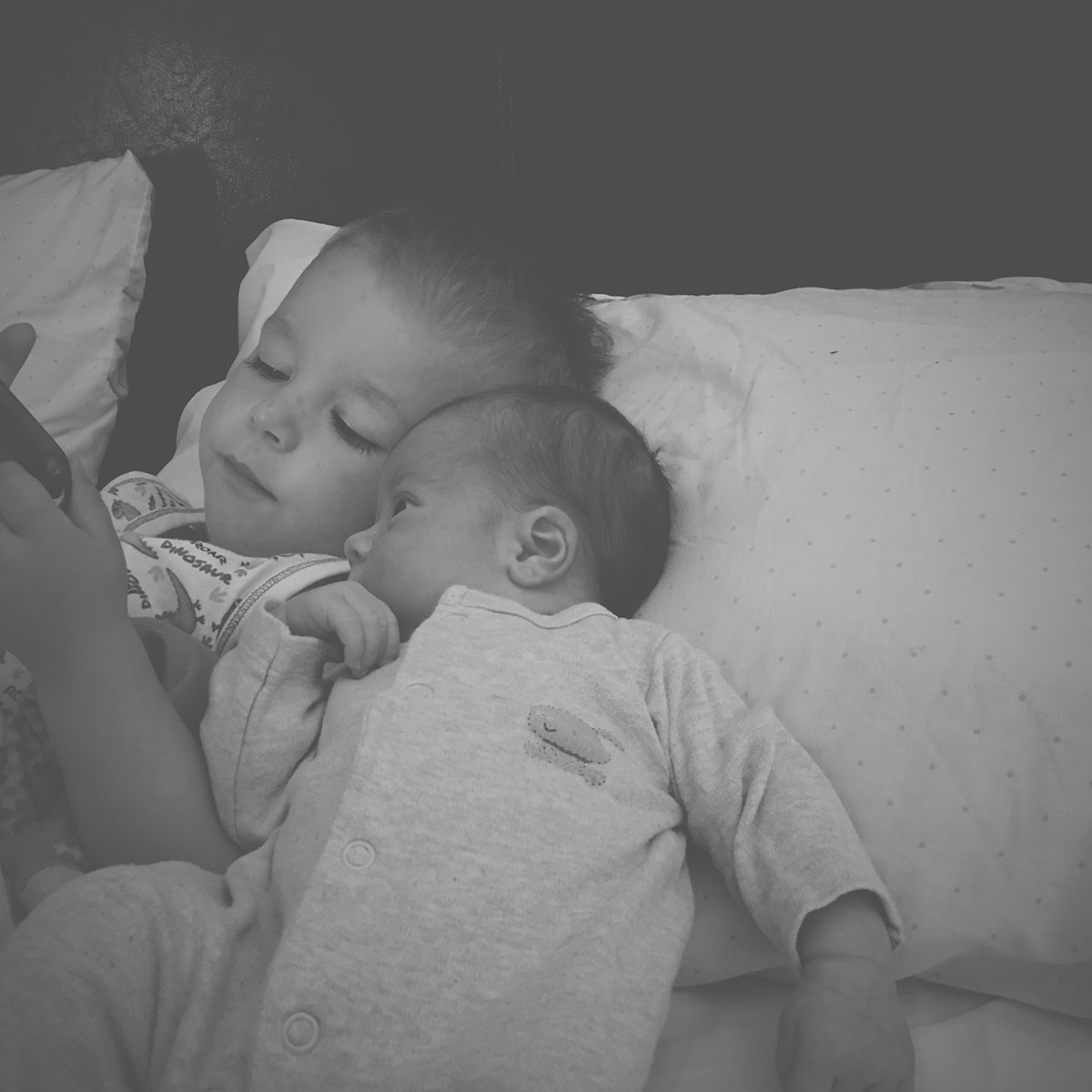 Our month in insta-snaps; August 2016 - Toddler and his new baby brother watching a video in bed