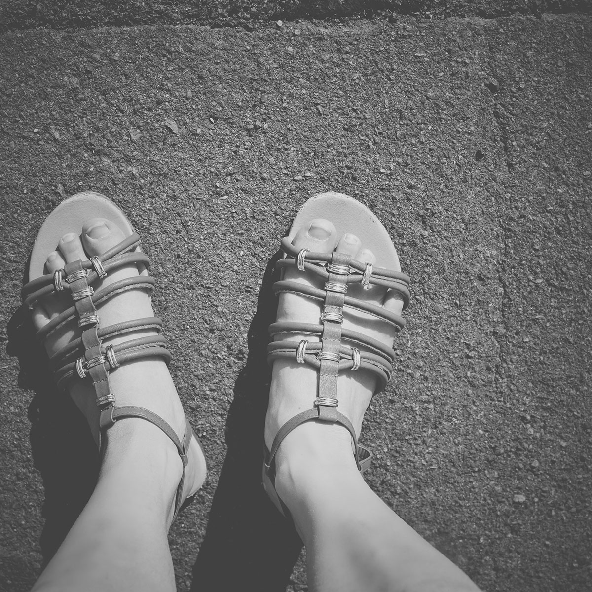 Our month in insta-snaps; May 2016 - Aerial shot of feet in sandals on a warm, sunny day for holiday