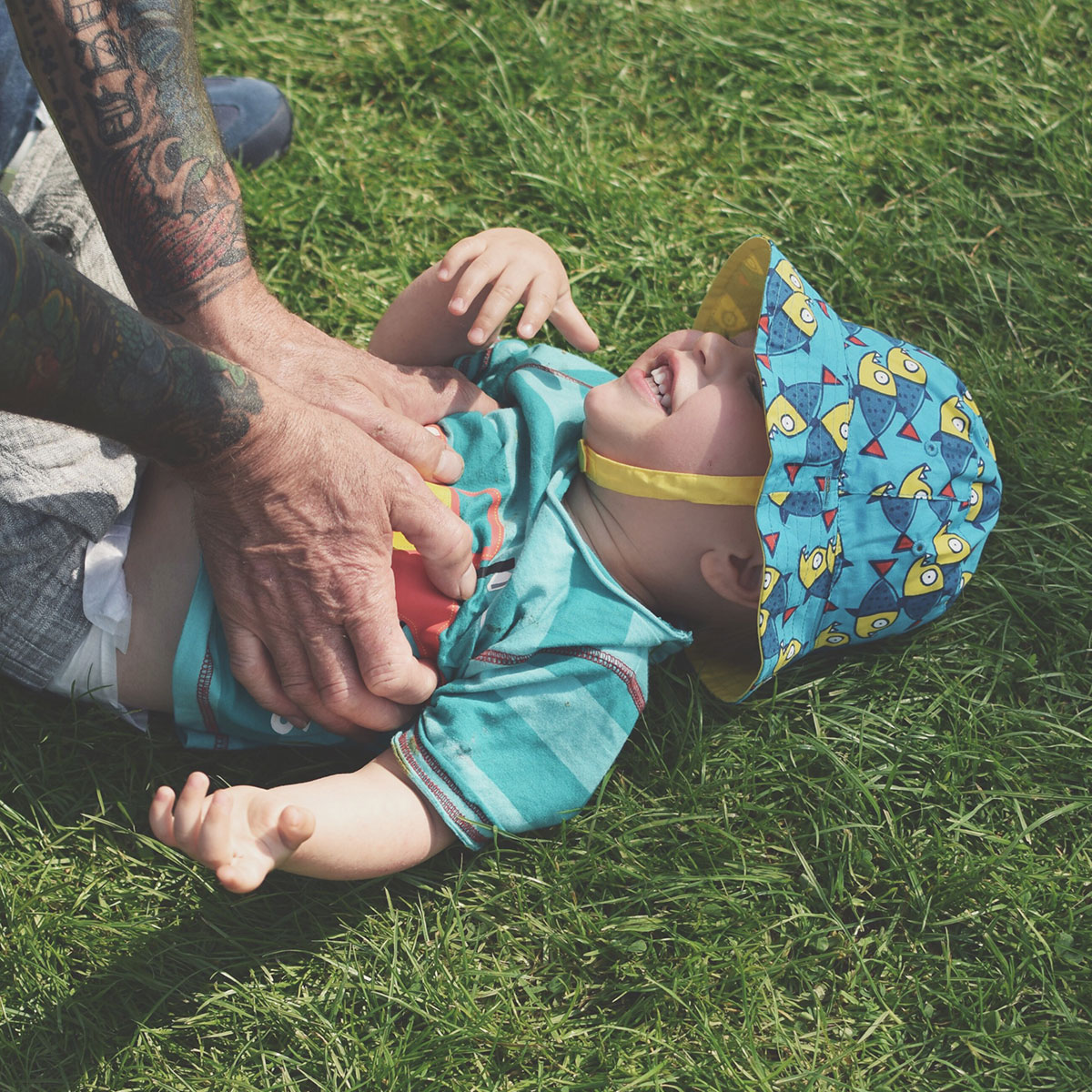 Our month in insta-snaps; May 2016 - Toddler laughing being tickled by Grandad in Stratford-upon-Avon on a sunny day