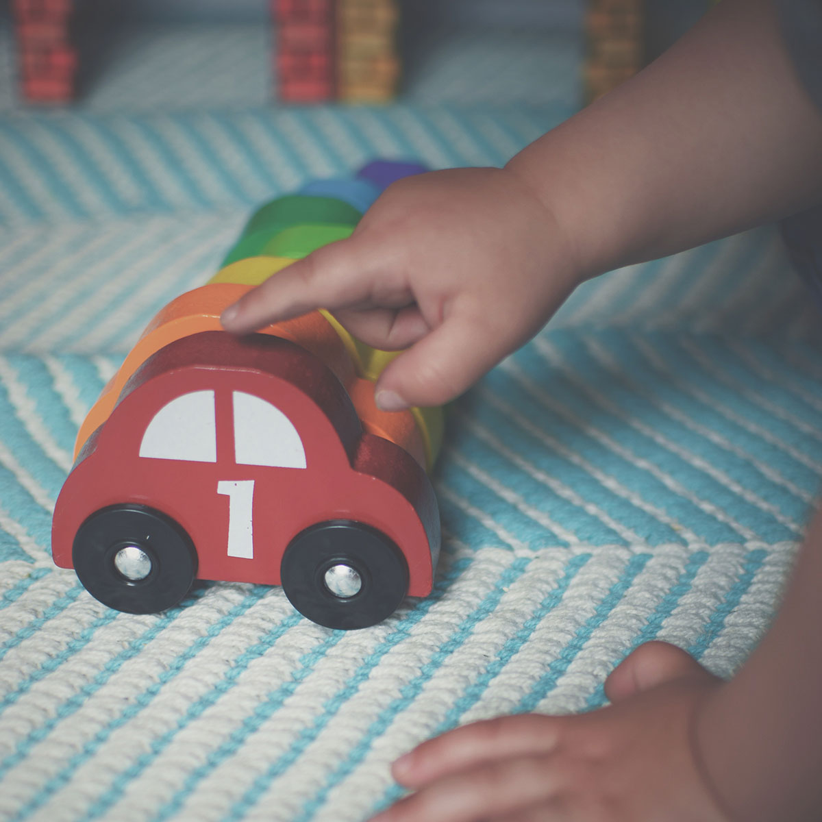 Our month in insta-snaps; May 2016 - Toddler playing with Melissa and Doug nesting rainbow cars and garages from Wicked Uncle toy website