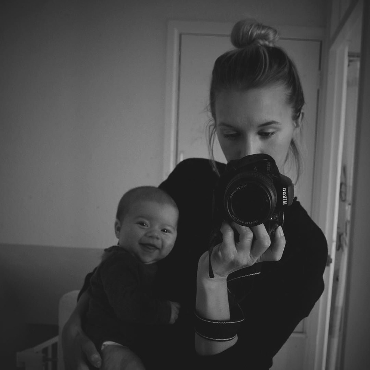 Our month in insta-snaps; October 2016 - Mother holding newborn baby boy whose smiling taking selfie in the mirror with messy bun
