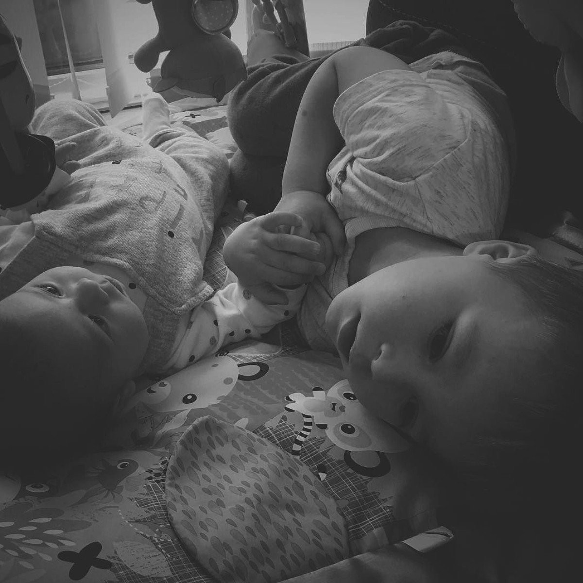 Our month in insta-snaps; October 2016 - Newborn baby boy and his toddler brother holding hands on activity mat