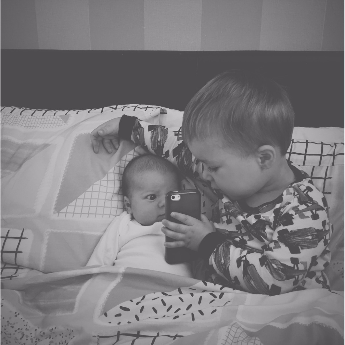 Our month in insta-snaps; October 2016 - Sibling brothers sitting in bed watching YouTube kids together