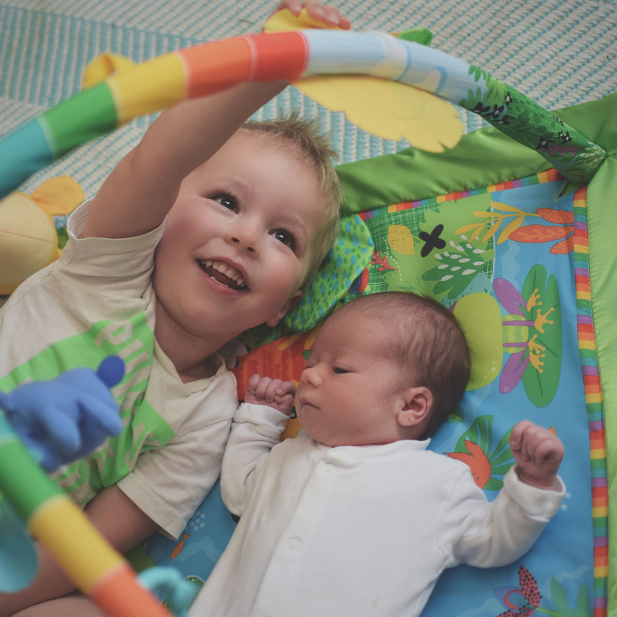 Our month in insta-snaps; September 2016 - Newborn baby and his toddler brother playing together on the Fisher-price rainforest deluxe music & lights activity gym