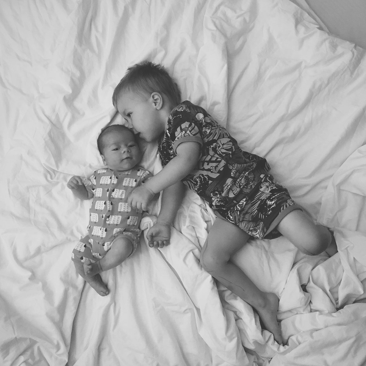 Our month in insta-snaps; September 2016 - Newborn baby and his toddler brother laying down together wearing H&M pyjamas