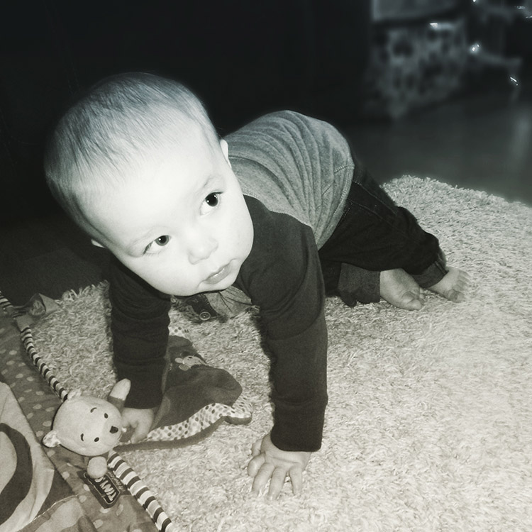 13 month old toddler baby crawling on floor