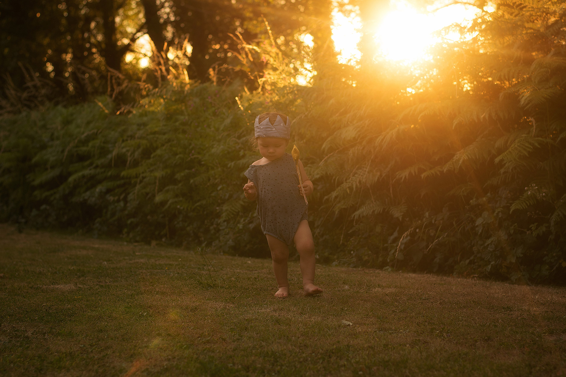 Celebrating the second birthday of a toddler with a golden hour sunset shoot wearing Maed for Mini spotted vest, fabric crown and wand in South Wales