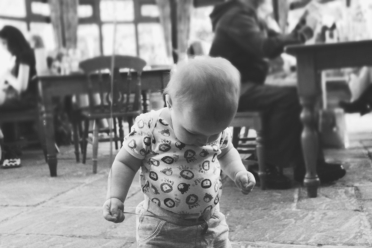 14 month old toddler holding balloon at the Three Crowns, Brinkworth