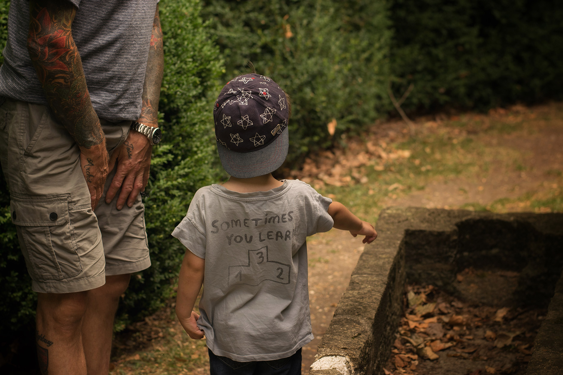 Young boy enquiring about pet graveyard at National Trust property Mottisfont House and gardens, Hampshire