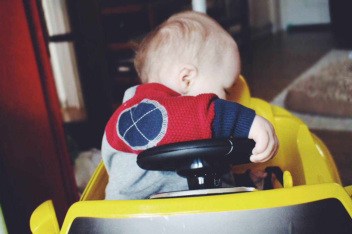 13 month old baby playing with toy car