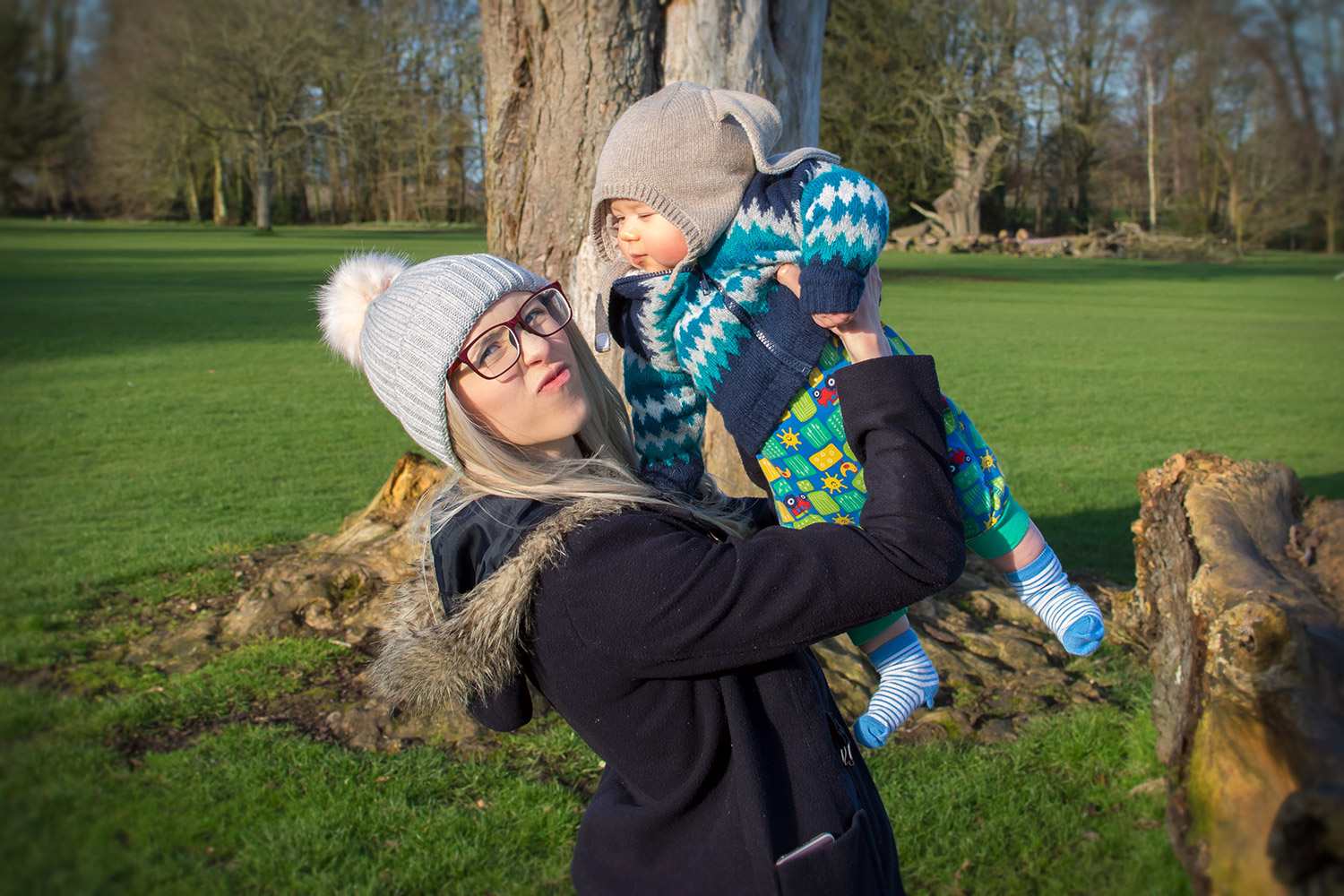 Bunnies x Boys — The Ordinary Moments #18; 6 month old baby boy wearing H&M bunny hat in Cosatto Giggle 2 pushchair in woodland print on a family day out at the park in Winter