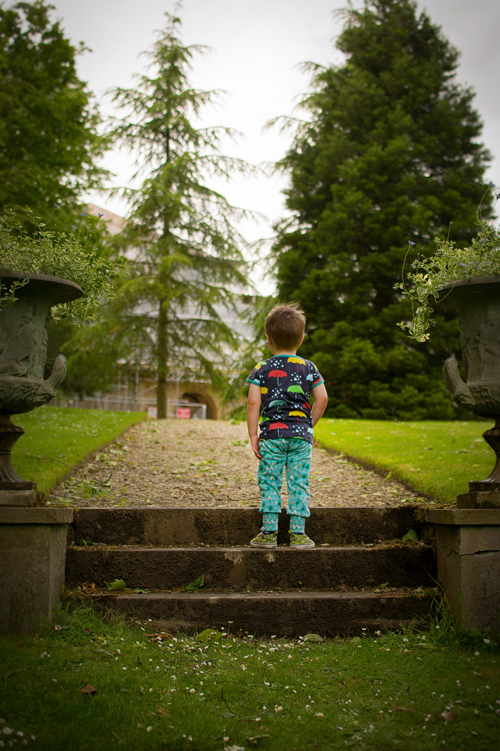 'Time to make a big decision' {The Ordinary Moments 21} - Pre-schooler wearing Duns Sweden umbrella t-shirt and Bear and Babe woodland leggings standing on the steps looking at the house in scaffolding at Buscot Park, Oxford