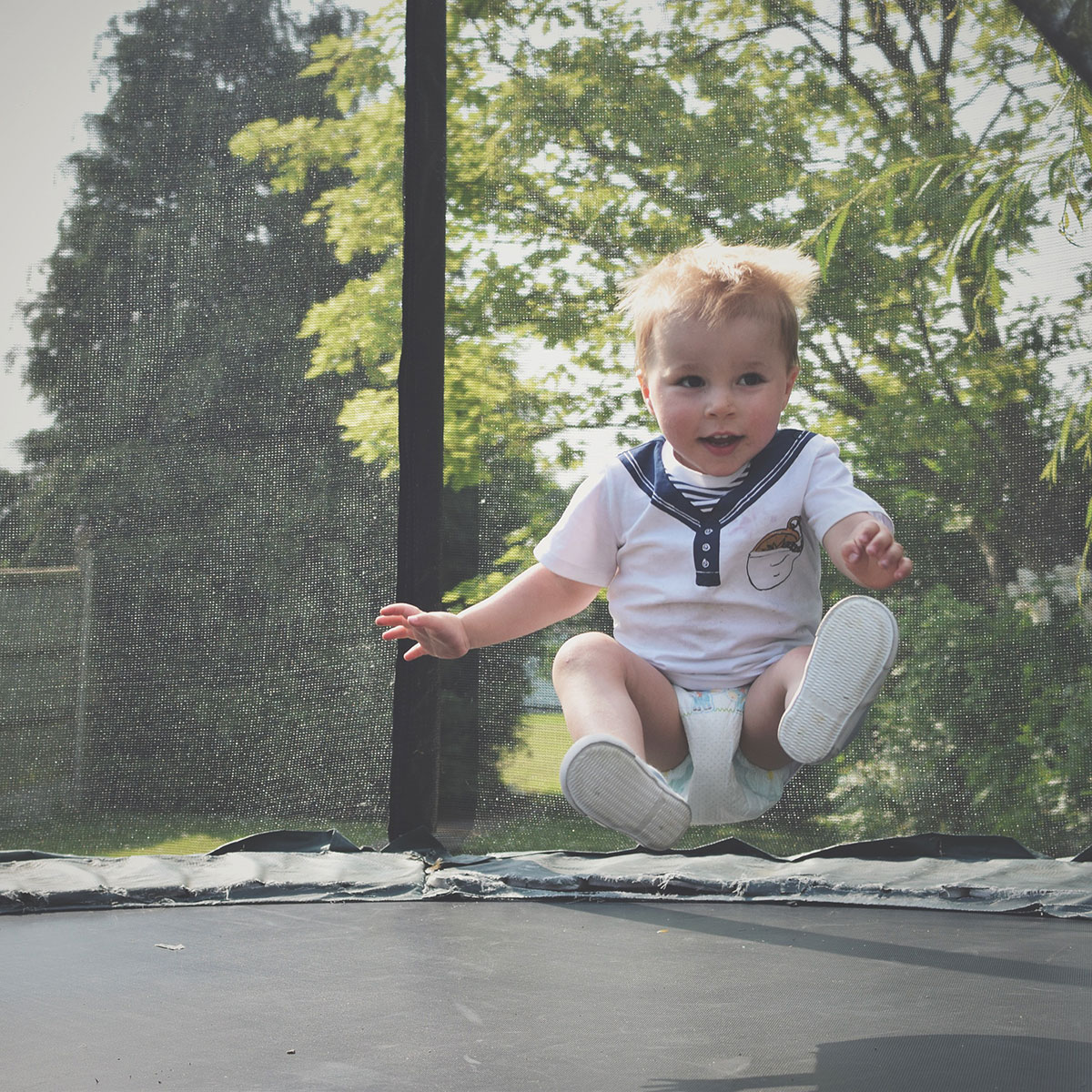 'A cousin is a little bit of childhood that can never be lost' — The Ordinary Moments #9; Toddler jumping on the trampoline at a Summer BBQ taken with Nikon D3300