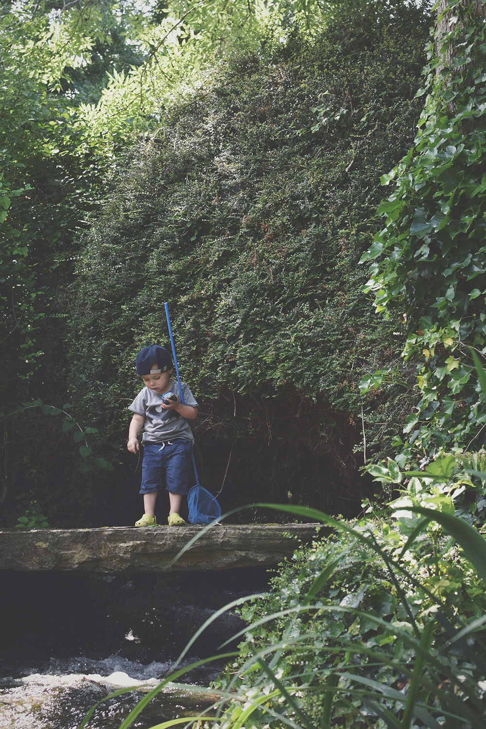The Cottage with the Waterfall — The Ordinary Moments #11; Toddler playing in the waterfall at beautiful centuries-old cottage in Wiltshire, beautiful gardens