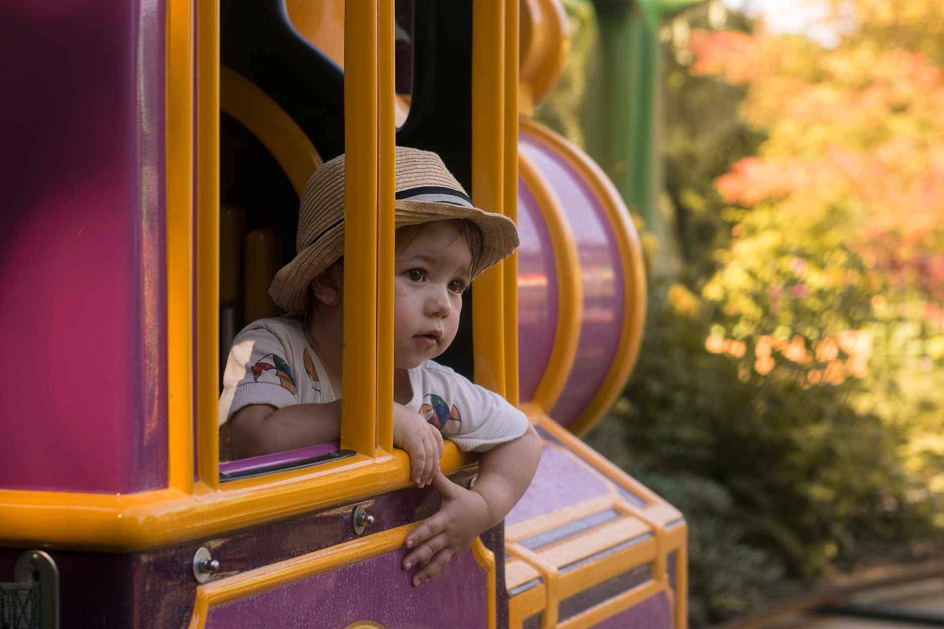 Toddler on train ride in Critter Creek - A family day out to Peppa Pig World and the Lost Kingdom at Paultons Park, Hampshire