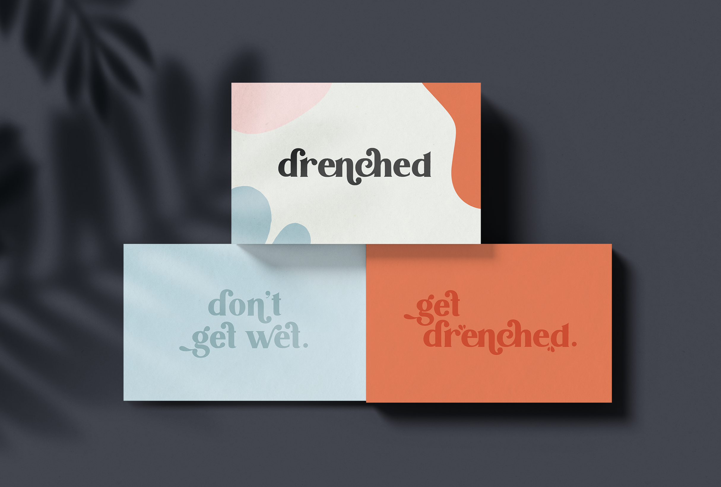 Business card design for Drenched, selling luxury products that are essential for water-based needs - designed by Wiltshire-based graphic designer, Kaye Huett
