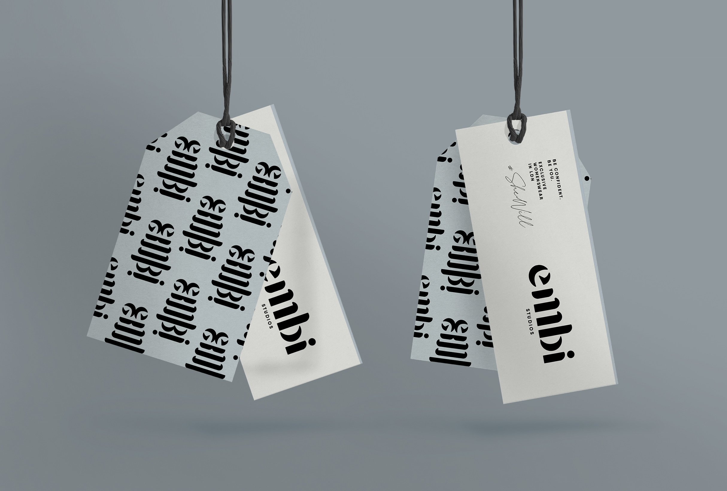 Hang tag design for Embi Studios, London-based clothing line offering unique items and limited edition seasons - designed by Wiltshire-based graphic designer, Kaye Huett