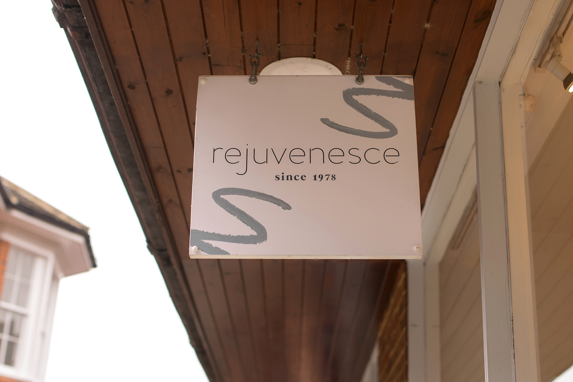 HAnging sign for high-end beauty salon, Rejuvenesce, based in Marlborough  - Designed by Wiltshire-based graphic designer, Kaye Huett