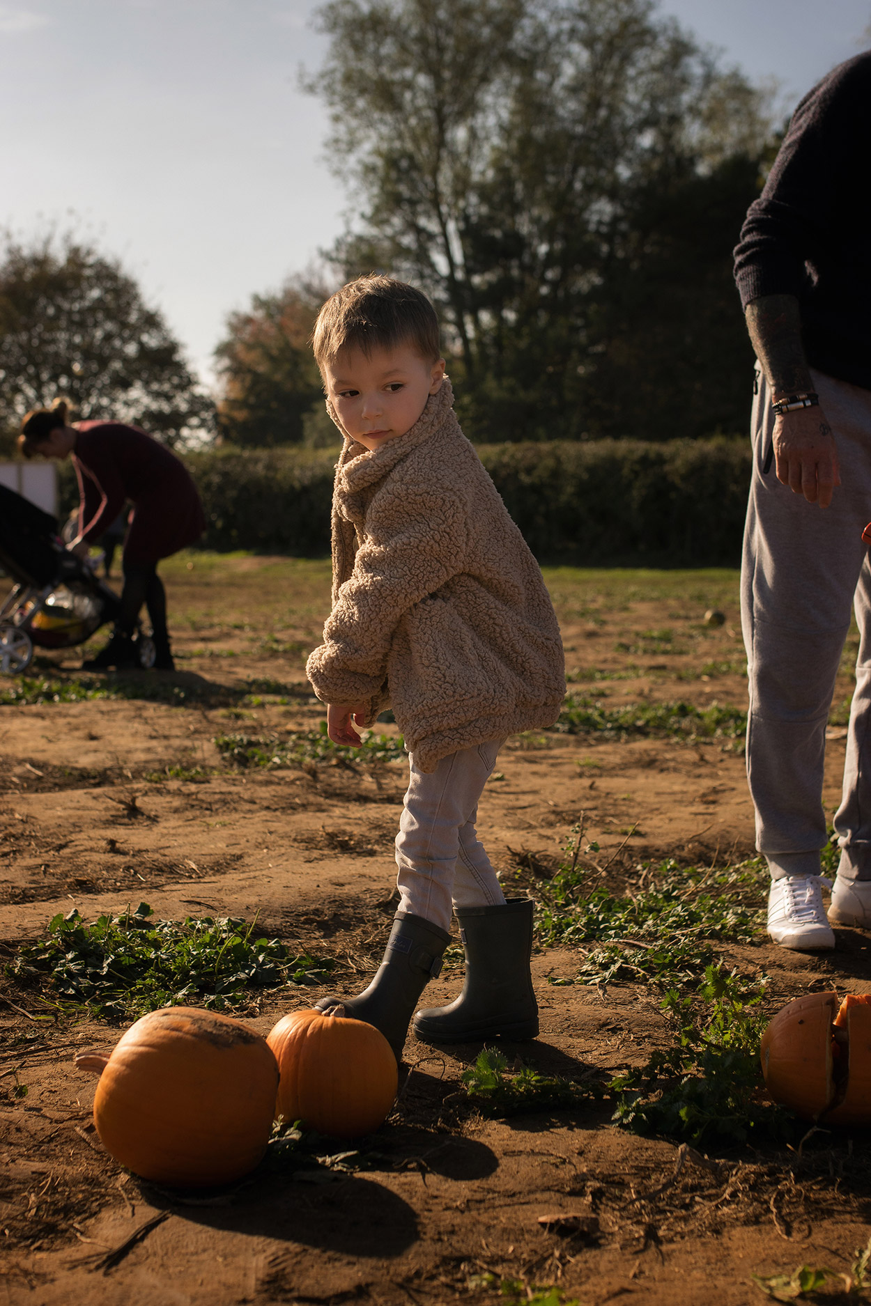 Young family with two young boys wearing The Animals Observatory and Rylee and Cru whilst pumpkin picking at Millets Farm, Frilford, Oxfordshire