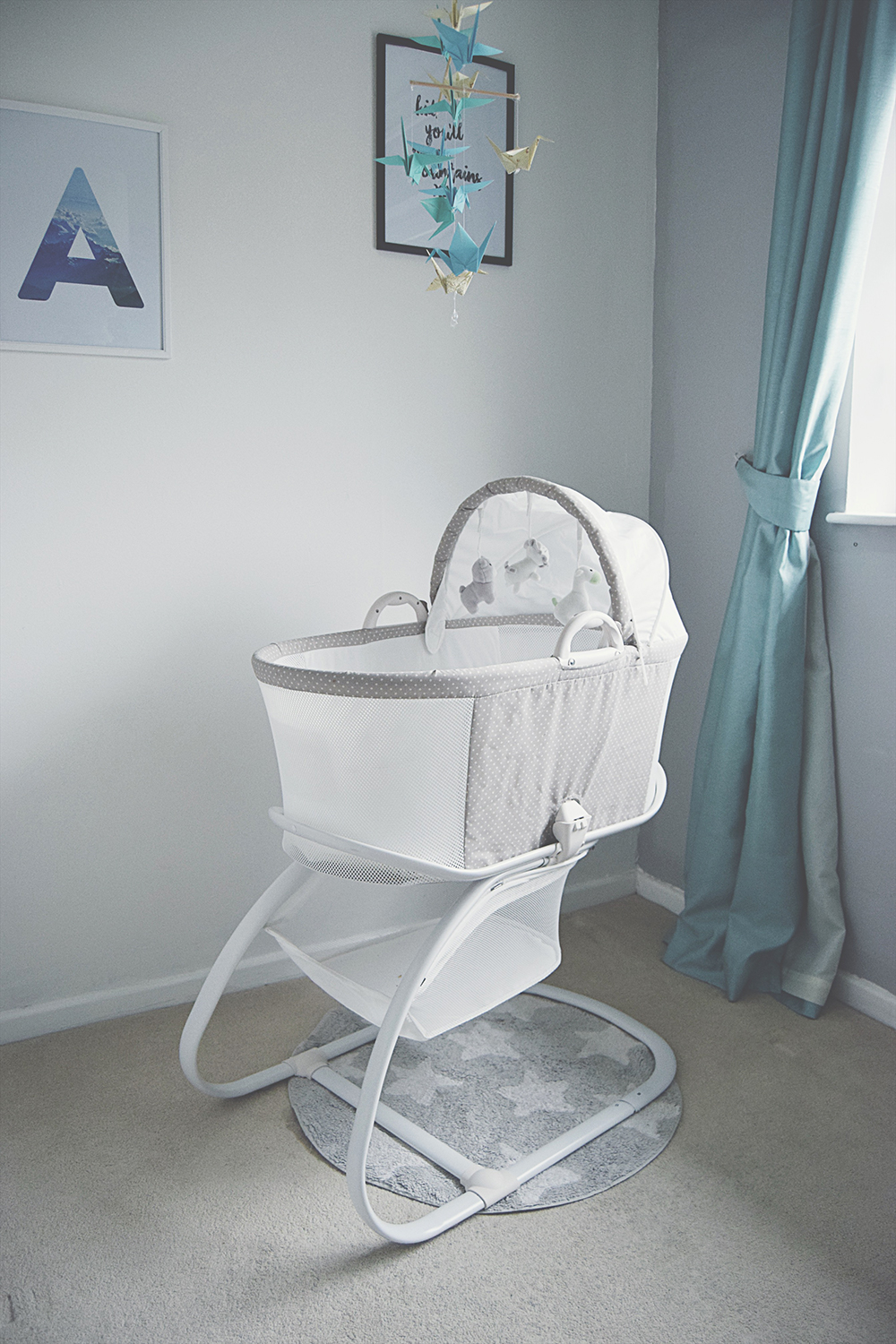 Why we wouldn't be without our PurFlo Bassinet - Newborn baby boy sleeping in the breathable PurFlo bassinet with vibration setting and white noise soothing centre