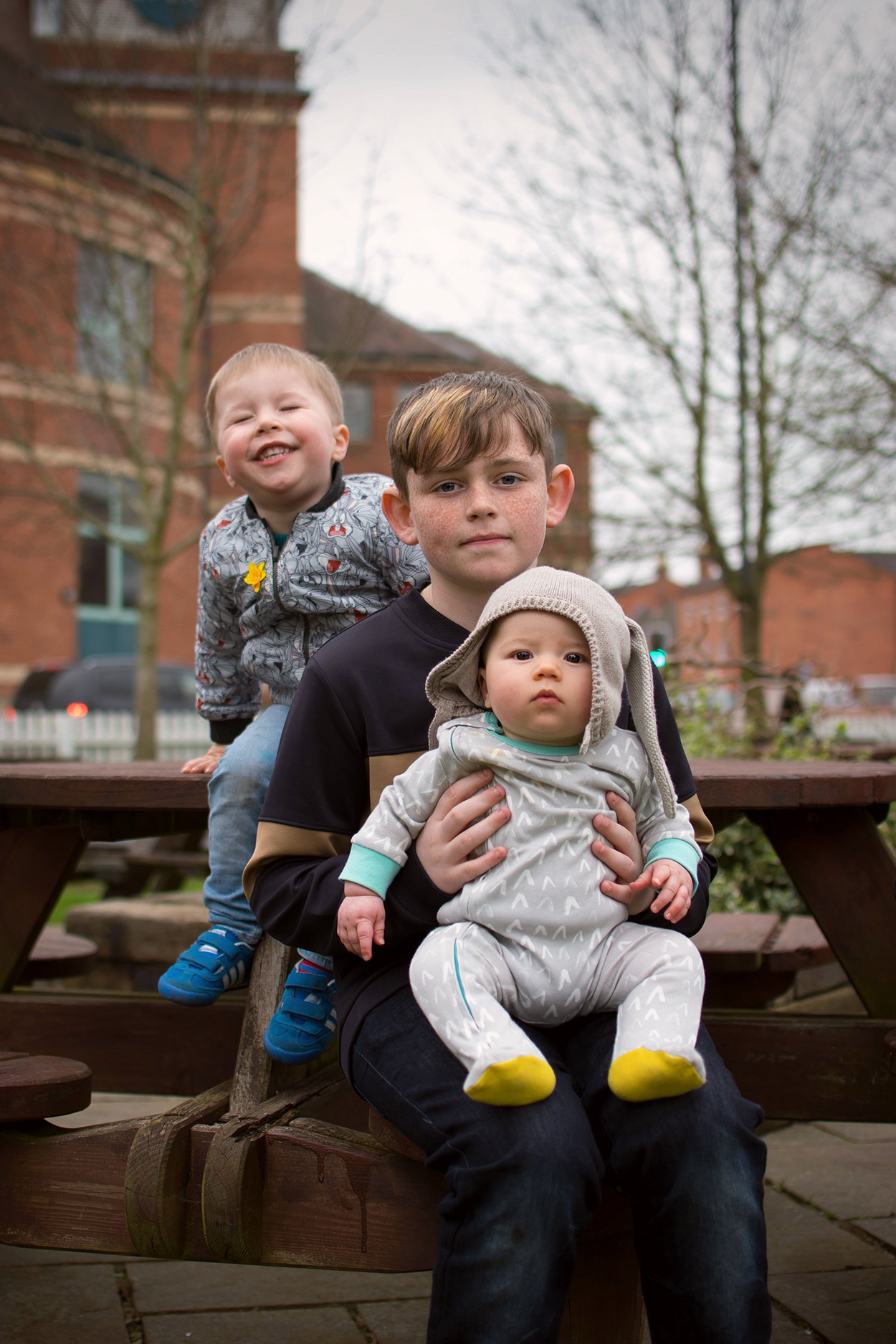 The Siblings Project {March 2017} - 11 year old, 3 year old and 7 month old baby brothers sitting together in Stratford-upon-Avon on a family day out for The Siblings Project with Dear Beautiful