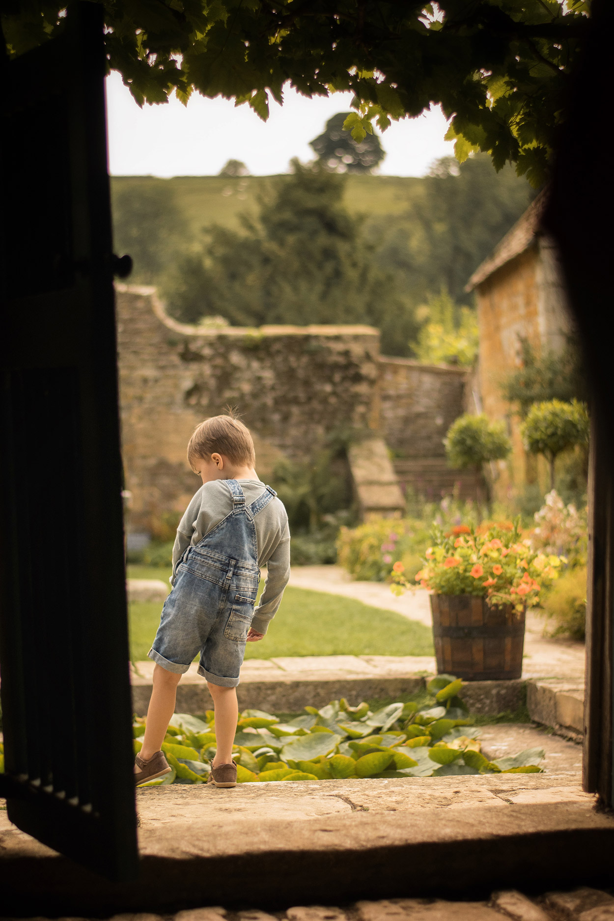 Family with two boys and grandparents visiting Snowshill Manor & Gardens, Gloucestershire, wearing Bobo Choses and Bobux