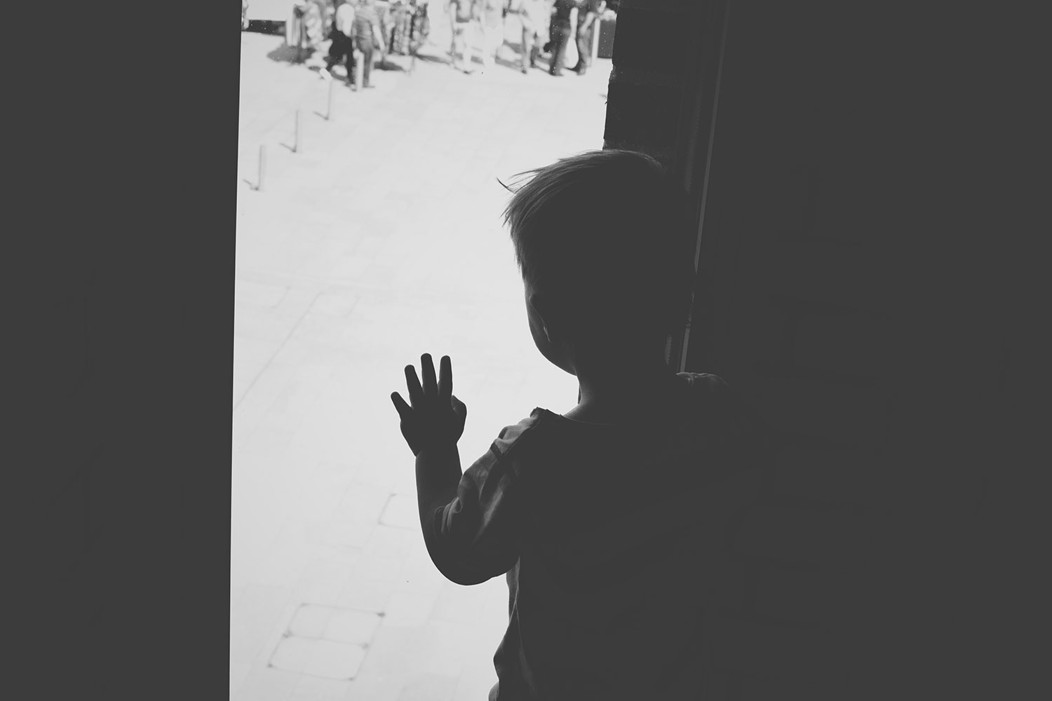 One Beautiful Sweaty Sunday at Stratford-upon-Avon - Toddler looking out of the window from the upper levels at the Royal Shakespeare Company Theatre