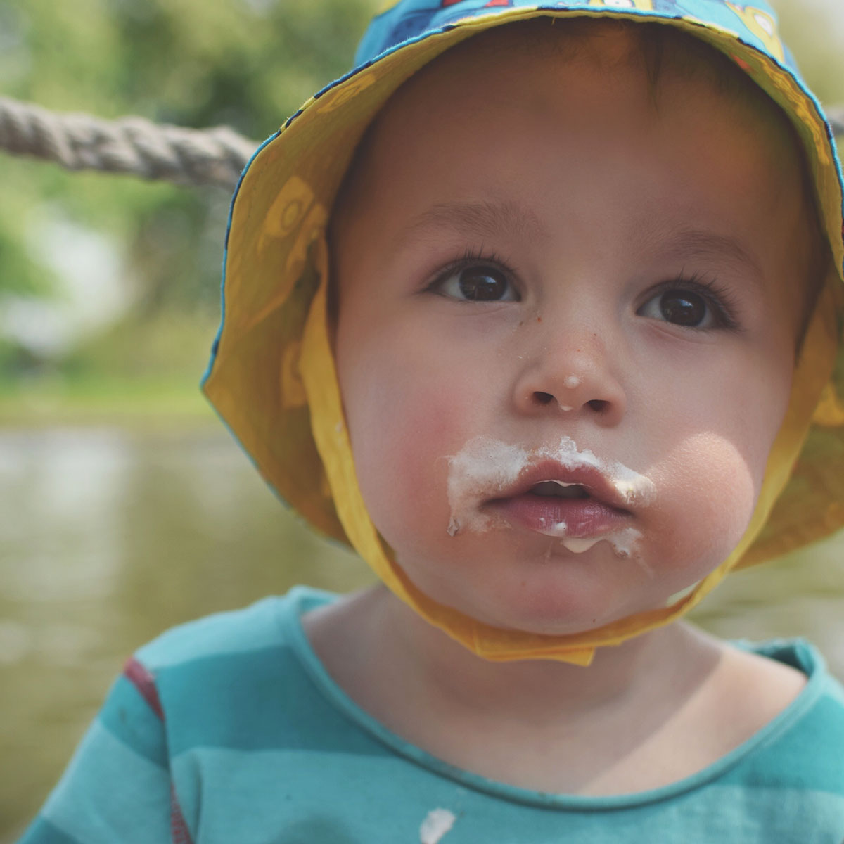 One Beautiful Sweaty Sunday at Stratford-upon-Avon - Toddler with ice-cream around his mouth on the boat on Summers day