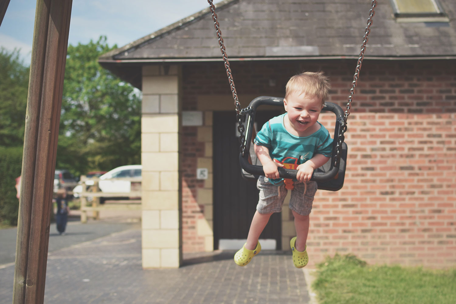 One Beautiful Sweaty Sunday at Stratford-upon-Avon - Toddler playing and laughing on the swings at Stratford-upon-Avon on a warm, sunny day