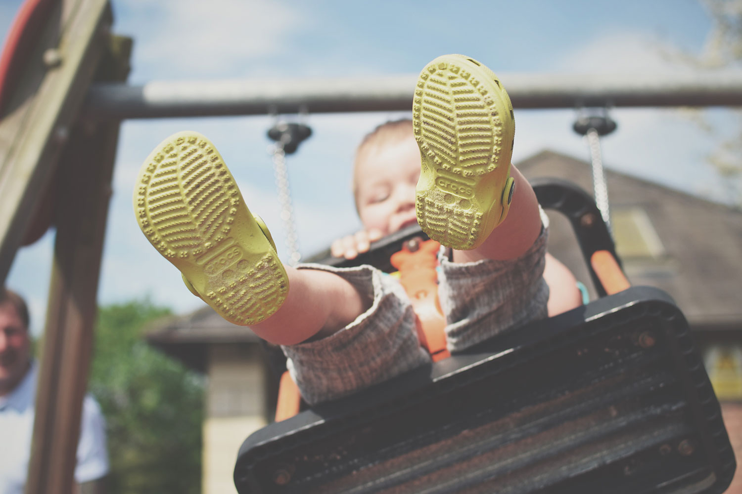 One Beautiful Sweaty Sunday at Stratford-upon-Avon - Toddler playing on the swings showing off his green Crocs shoes at Stratford-upon-Avon park