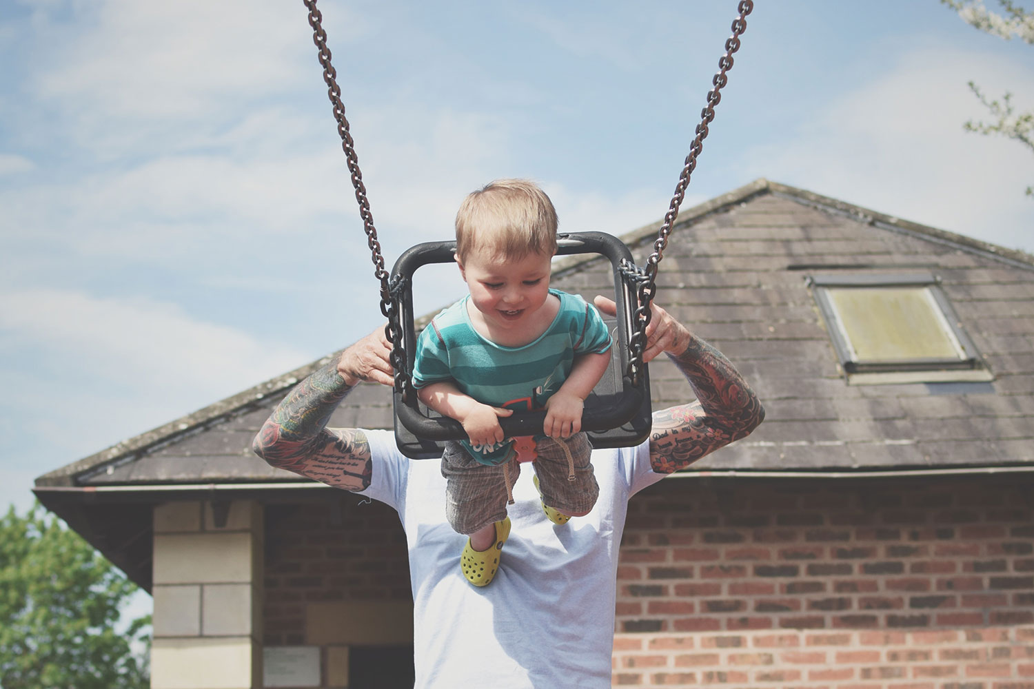 One Beautiful Sweaty Sunday at Stratford-upon-Avon - Toddler laughing and giggling being pushed on swing by Grandad at Stratford-upon-Avon park