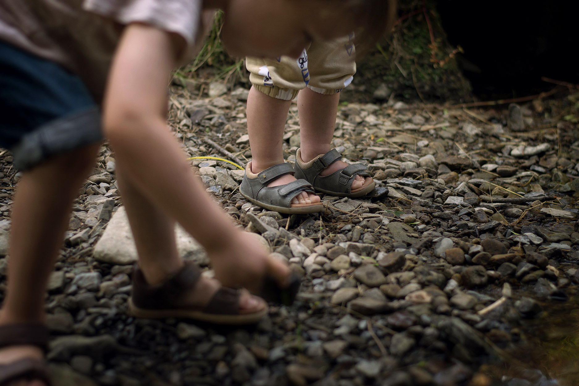 Toddler wearing Bobux driftwood sandals in black ash at Colby Woodland Gardens, National Trust