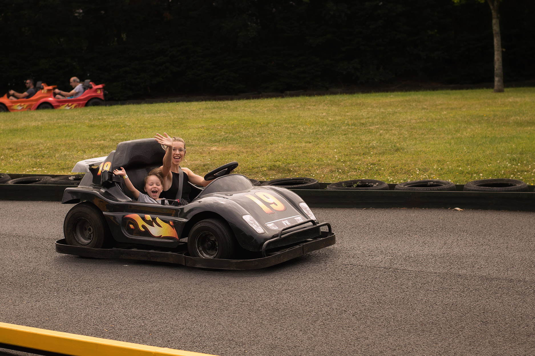 Mother and son in the go-karts at at Folly Farm, Wales