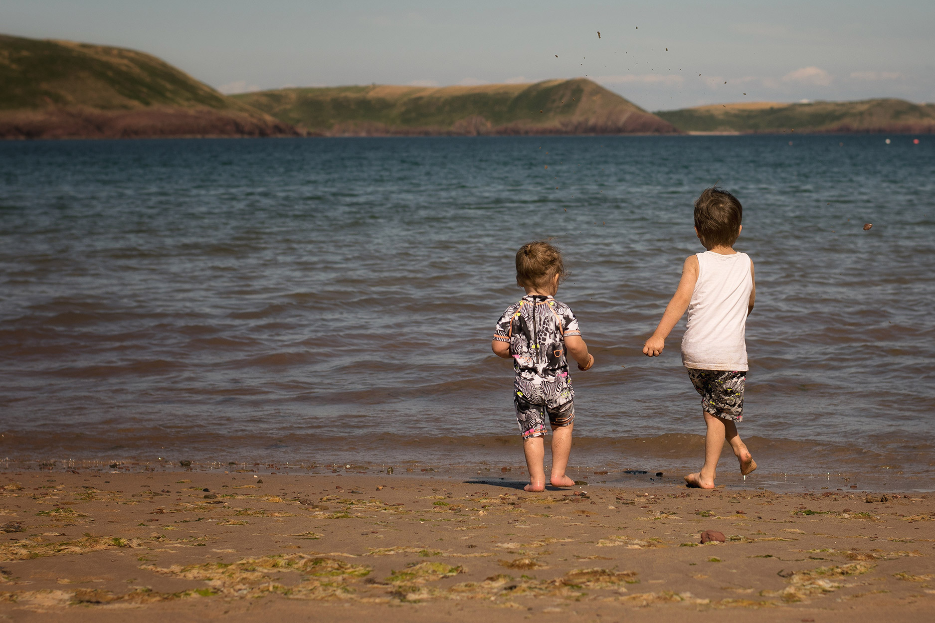 Toddler wearing Next swimwear at the sandy beaches of Freshwater East, South Wales