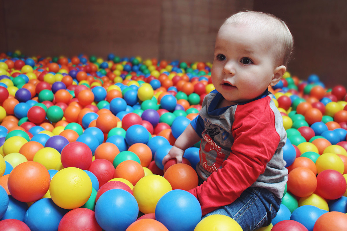 Babies playing in ball pit at Roves Farm, Swindon